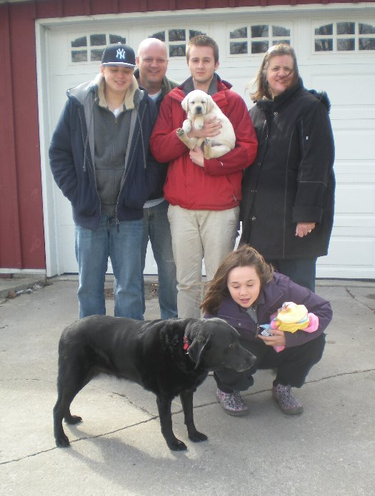 Teddie with her new family and their other current Pirate Labrador, 12 yr. old Billie