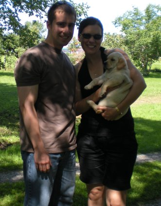 """""""Bella"""" with her new parents"""