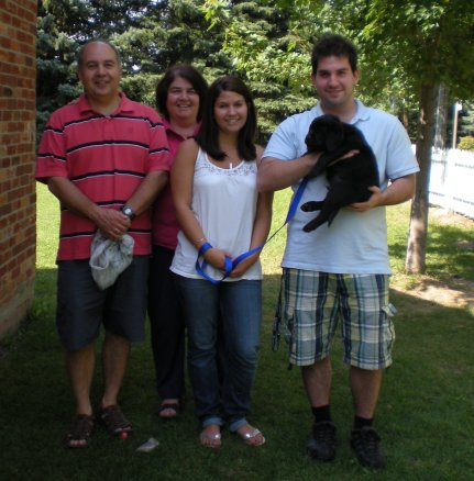 """Sam"" with his new family"