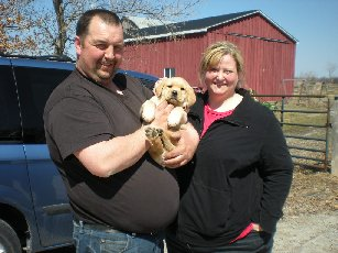'Ollie' with his new parents!